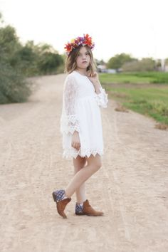 Like wildflowers you must allow yourself to grow in all the places people thought you never would. #bsteelephotography #childmodel #kidmodel #phoenix #arizona #flowergirldress #militarychild #flowerheadpiece #shorthair #blueeyes #booties