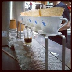 Blue Bottle Coffee: Brewing Vietnamese Coffee and a neighbor to The Slanted Door in San Francisco's Ferry Plaza Coffee Menu, Drip Coffee, V60 Coffee, Journey Coffee, Slanted Door, Blue Bottle Coffee, Coffee Branding, Bar Set, Coffee Maker