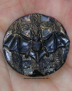 Victorian Bat button on jet black glass. among the collectors ©2014 dan ruth