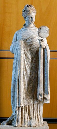 Woman holding a mirror,terracotta figure from Tanagra,Greece,4th century BC  Museum of Fine Arts of Lyon