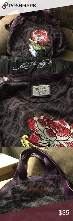 Ed Hardy Bag Classic Ed Hardy handbag with cross body strap attached. Exterior is in great condition. Interior around zipper is stained. Super fun!!! Includes dust cover. Ed Hardy Bags Crossbody Bags