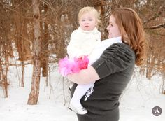 Amanda Abraham Photography specializing in newborn and child photography. Using fun props to enhance your photo experience in the Metro Detroit area! www.amandaabrahamphotography.com Winter Valentine Themed Maternity session with Mom, Dad, and daughter in the snow!