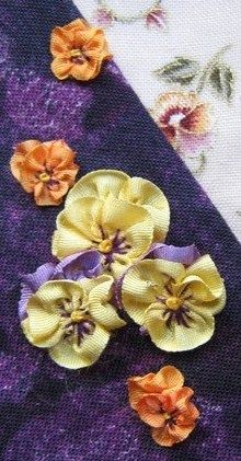 Hand Needlework - How to make ribbonwork pansies · from Threads and Patches via CraftGossip.com