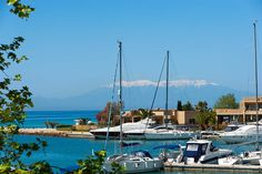 Wonderful view of Sani Marina with Mount Olympus appearing in the background. Halkidiki Greece, Mount Olympus, Crystal Clear Water, Peace Of Mind, Planet Earth, San Francisco Skyline, Places To Visit, Beach, Heaven