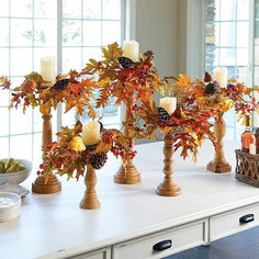 This lavish candle ring features bold and bountiful pre-lit berries, pods, leaves and more in the oranges, yellows, greens, and browns of the fall season. Use our autumn harvest candle ring to create a lovely centerpiece on your table. Place it on your mantel, too.