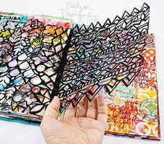 Lacy cutout sheets taped into your art journal - VERY COOL! from the Balzer Designs Blog: Art Journal Every Day