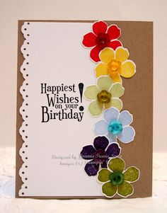 Gorgeous card , with a rainbow of flowers.  ♥ the button centres on the flowers, they make the card pop!