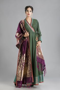 The feeling of regality touches a high in a deep velvety green Angarakha Anarakali steeped in Awadhi style for all who love the look of traditional cuts and designs. Indian Dress Up, Indian Attire, Indian Ethnic Wear, Indian Outfits, India Fashion, Girl Fashion, Fashion Dresses, Daily Fashion, Fashion Design