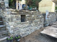 Stone retaining garden wall  With planter hole :)