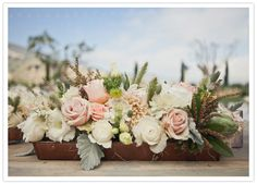 muted flower box centerpiece of roses, peonies, and lambs ear