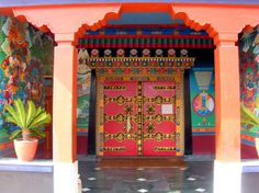 Red door, Tibetan Buddhist, Kopan Monastery Doors with mandala, guardians, Kapan Village, Kathmandu, Nepal by Wonderlane, via Flickr