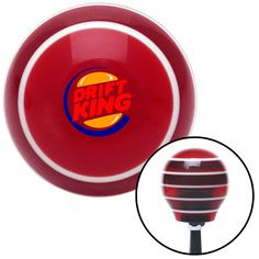 Drift King Logo Red Stripe Shift Knob with M16 x 15 Insert - Give your interior the ultimate look. American Shifter's Elite(TM) series shift knobs are made from the highest quality components resulting in a superior feel on every shift. Each shift knob is designed and customized in the USA by skilled shift knob artisans who have a trained eye on every detail. American Shifters shift knobs offers an exclusive aluminum threaded insert designed to be screwed onto your shift arm. You should…