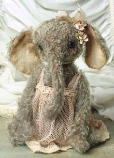 """heidi steiner winsome mabel elephant. How cute is this?  A sweetfaced, trunked toddler is a coveted original by the highly collectible designer. Hand sewn of curly mohair with weighted shot and movable joints, she is tenderly crafted with vintage materials. 10"""".  $249.95"""