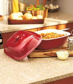 This Glazed Stoneware Bakeware will have you cooking like a pro. The stoneware absorbs excess moisture while evenly heating food. Its exterior features a red glaze, and the interior is natural stone. The Covered Roaster (3.75 qt.) includes a lid to seal...  ~XOX