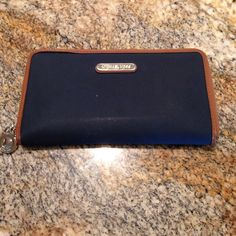 Michael Kors navy and brown wallet Just bought it on posh but found another wallet that matches my purse better! In great condition except for corners which is pictured! MICHAEL Michael Kors Bags Wallets