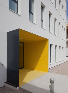Modern Health Center Building in White and Yellow Porreres Health Center