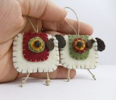 This pair of little sheep ornaments were all hand stitched and appliqued using the teeniest pieces of felt and even teenier stitches!
