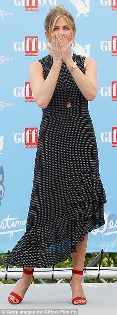 Looking fab: Jennifer showed off her svelte figure in a gorgeous polka dot dress teamed wi...