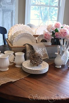 This looks like the basket on my dinning room table with all my white dishes in it!