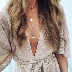 deep v-neck dress and layered necklaces