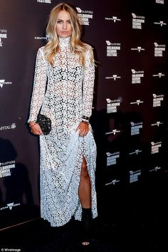 Racy in lace: Elyse Knowles flashed her black lingerie in a white see-through lace dress as she attended the VAMFF Premium Runway Show in Melbourne on Thursday night