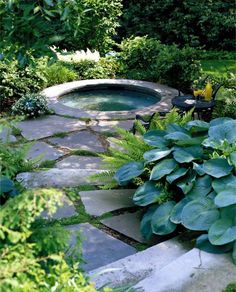 outdoor Jacuzzi and buried driveway slabs of gray stone