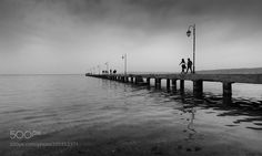 Walking in  Pier by IoannisIoannidis