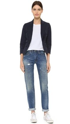 Paint spatters and repaired patches give this tailored DSQUARED2 blazer an artistic, well-traveled finish. Peaked lapels and single-button closure. 4 front pockets. Double-vented, uneven back hem. Long sleeves and button cuffs. Unlined with finished interior seams.