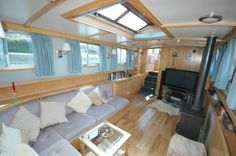biult in sofa. roof windows. nice colour pallet. dutch barge