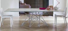 Octa tavolo, piano in ceramica bianca e basamento in metallo cromato