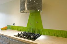 This ultra modern kitchen required a sharp, citrus burst of green. This simple design achieves that with perfection. The glass is kept to a shorter depth across the worktops and the splashback itself is shaped to place more attention on the countertop. In this way it creates something of a theme instead of being a piece of wall art by itself. Not to mention, this keeps the look contemporary.