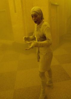 Marcy Borders, covered in dust, takes refuge in an office building. She died in 2015, after a battle with cancer.