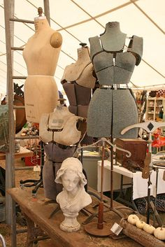 Vintage dress forms at a flea market.