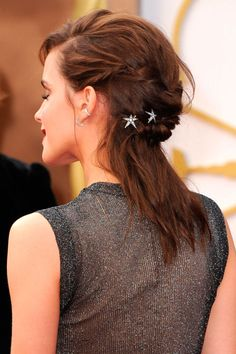 Take inspiration from Emma Watson and add miniature hair accessories to a messy updo.