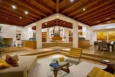 Contemporary Living Room with simple marble floors, Exposed beam, Sunken living room, High ceiling
