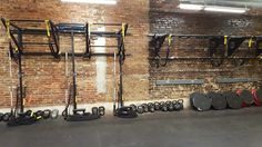 Double Wall FTS and Pullup bracket System wall mounted in an exposed brick wall. Suspension training, TRX, functional fitness for group workouts in this small but space efficient fitness studio