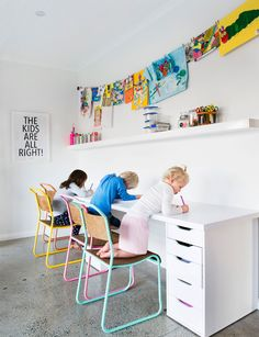 Matilda, Mack and Lulu love to draw and paint in the playroom, and the concrete floor makes for easy clean-up.