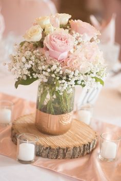 Rose and hydrangea centerpiece with painted mason jar and wood round