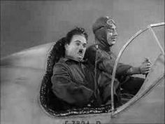 Charlie Chaplin - The Great Dictator - in a plane. This is easily the funniest scene in all of film. Chapin is a genius