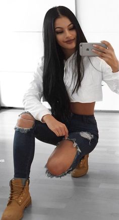 ripped jeans, white hoodie, timberland! click for more..