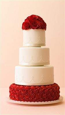 Elegant white wedding cake with rose layers
