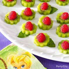 PArty Food Use flower cookie cutters to shape delicious kiwi fruit into beautiful, tasty treats. Raspberries stand in for the center of the flower with basil for the leaves.