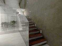 Zona de entrada principal a casa unifamiliar. Detalle de pared en cemento pulido, escalera con peldaños de madera y cristal corrido desde planta baja hasta ultima planta