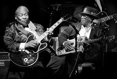 Two blues greats for the price of one: B.B. King and Bo Diddley play dueling guitars for the second anniversary celebration of B.B. King's Blues Club & Grill in New York's Times Square.   (June 20, 2002)