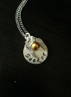 Harry Potter Necklace Seeker with a Golden Snitch Charm<< I want the except with a Quaffle and Chaser written on it