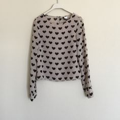 H&M pink black hearts long sleeve crop XS 2 Beautiful crop top with heart prints. Exposed zipper in back. Front is lined and back is more sheer. Button details on cuffs. Only worn once in excellent condition. Bundle to save 25%! H&M Tops Crop Tops