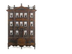 Early oak dolls house:  THE FORSTER BABY HOUSE:  A rare George II Palladian carved mahogany Baby House