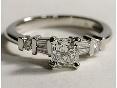 Radiant cut center stone with round and baguette set in platinum.  My beautiful engagement ring!
