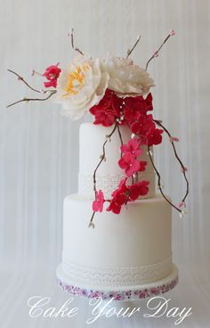 Wedding cake with peony and hydrangea sugar flowers.
