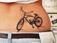 Small bike tattoo